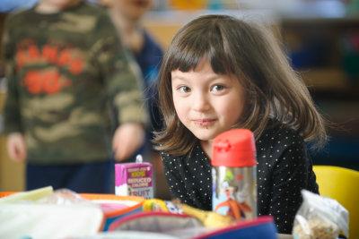 friendly preschooler girl at school