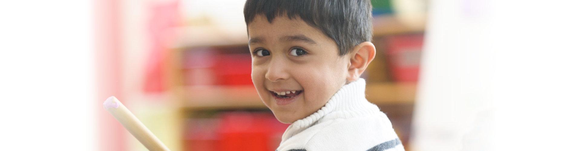 Kid smiling at the camera